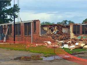 The East wing of the old Grand Saline Elementary School is first to go during demolition. 8/16/2016