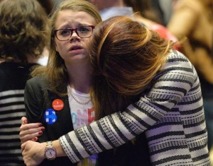 A girl looks at the elections results dumbfounded as she is hugged by her mom at the DFL Election Night Party at the Hilton Minneapolis on Tuesday, Nov. 8 2016. (Pioneer Press: John Autey)
