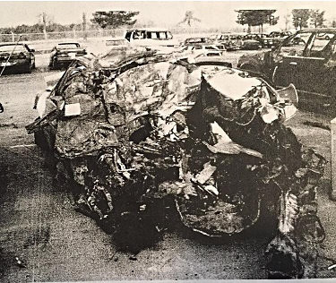 This is what remained of the car I was standing next to just before the wreck. Miraculously, the young lady who was driving, and the baby she was carrying at the time, survived and was released from the hospital the next day.